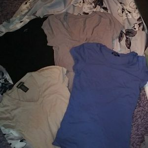 Lot of 4 form fitting basic tees